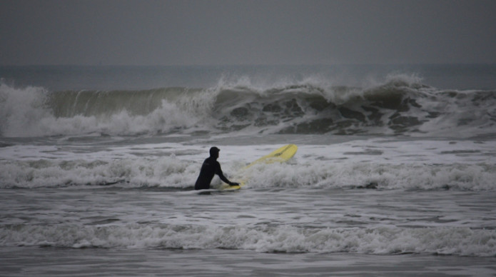Surfer surfing on the sea in winter
